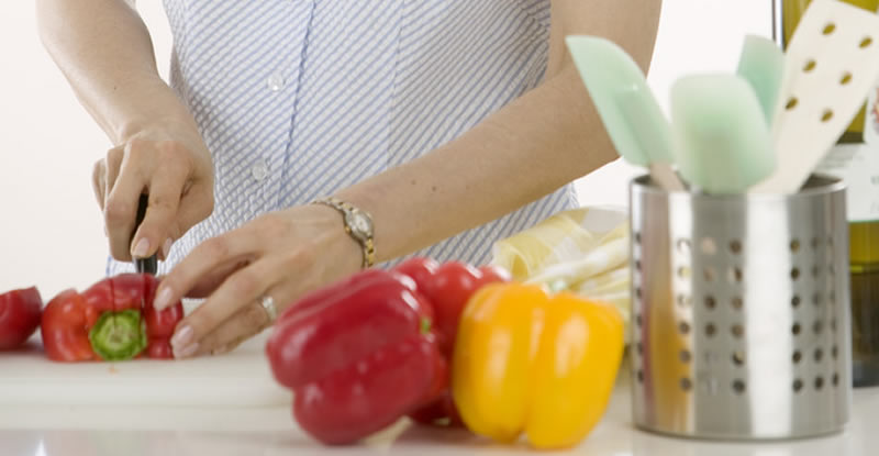 Woman cutting peppers